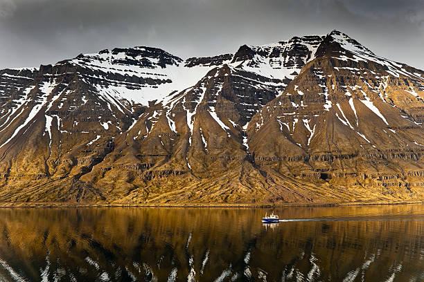 Fishing boat on fjord.