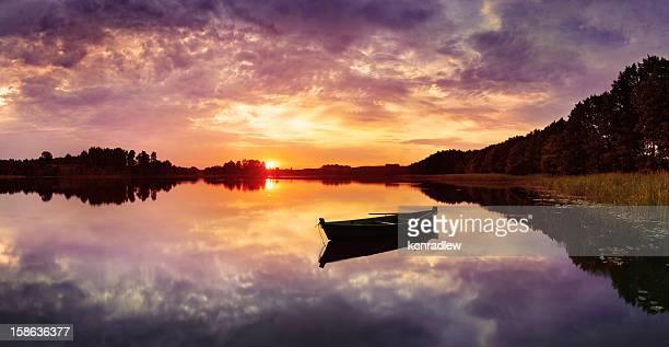 Fishing Boat on Lake during Colorful Sunset - HDR Panorama
