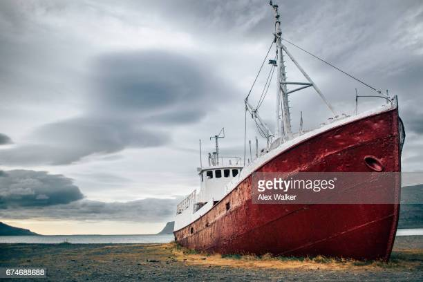 A fishing boat on land in the Westfjords, Iceland