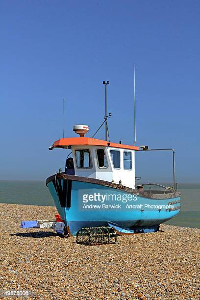 fishing boat on shingle beach. - aldeburgh stock photos and pictures