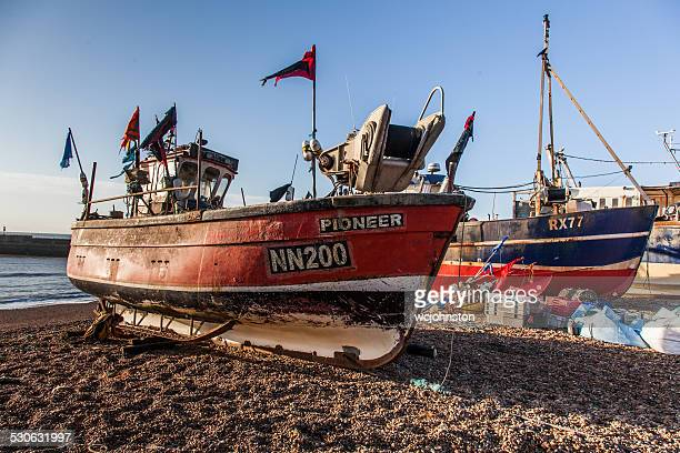fishing boat on the beach at hastings - hastings stock photos and pictures
