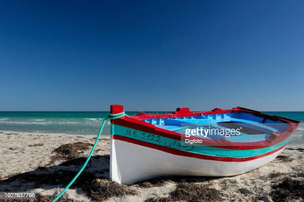 fishing boat on the beach, djerba island, tunisia, maghreb, north africa - djerba stock pictures, royalty-free photos & images