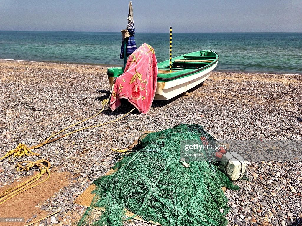 Fishing boat on the beach, Muscat, Oman : Stock Photo