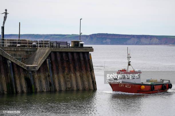 A fishing boat returns to harbour in Scarborough UK on Tuesday June 2 2020 The threat of a nodeal Brexit is back and with it the risk that the UK...