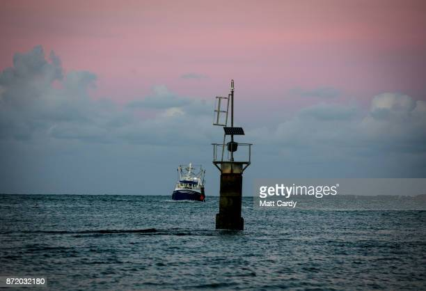 A fishing boat returns to Peel harbour on November 7 2017 in Peel Isle of Man The Isle of Man is a lowtax British Crown Dependency with a population...
