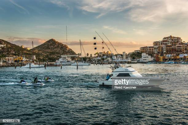 A fishing boat returns to the harbor at Cabo San Lucas after a day off shore chasing game fish.