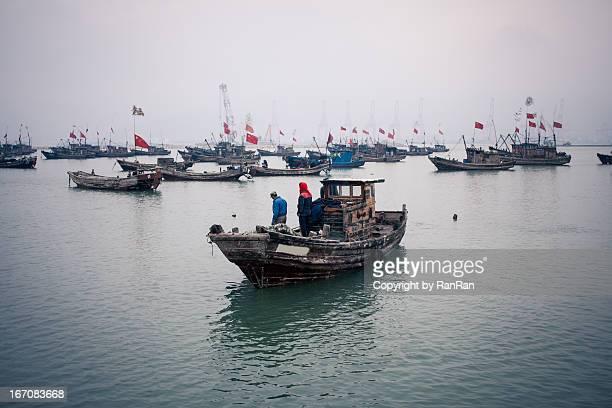 Fishing boat returns to the wharf