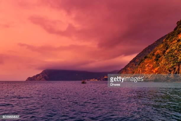 Fishing Boat Sailing Under Dramatic Sky
