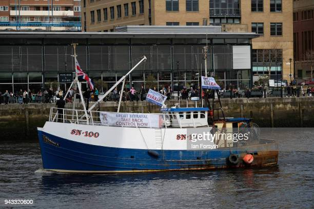 A fishing boat sails up the River Tyne as fishermen take part in a nationwide protest against the Brexit transition deal on April 8 2018 in Newcastle...