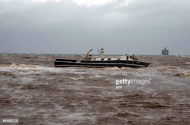 A fishing boat sinks during cyclone Mick the first of the summer cyclone season in the South Pacific near Lautoka Viti Levu Fiji on December 14 2009...