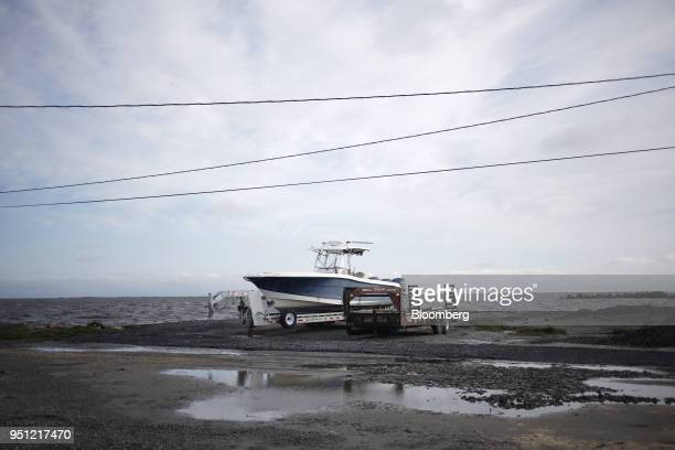 A fishing boat sits on a trailer in Grand Isle Louisiana US on Friday March 30 2018 In Louisiana the combination of rising seas subsiding land around...