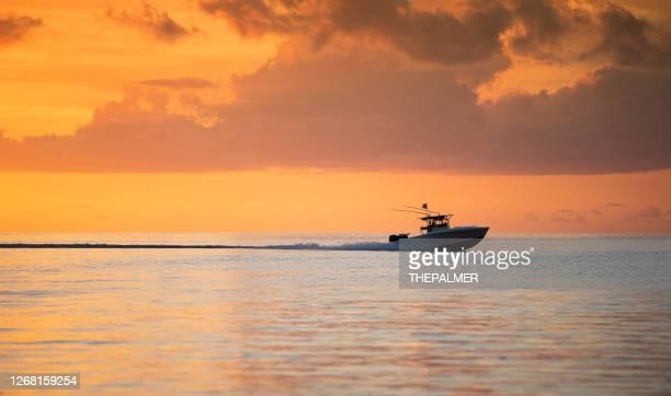 fishing boat speeding key largo florida - gulf coast states stock pictures, royalty-free photos & images