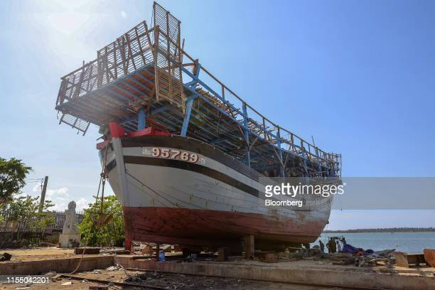 A fishing boat stands under repair at a shipbuilding company in Quang Nam province Vietnam on Wednesday June 26 2019 Fishermen are on the front lines...