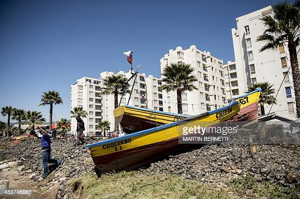 A fishing boat that was ran aground by the sea while berthed in Coquimbo some 445 km north of Santiago during the eve's earthquake on September 17...
