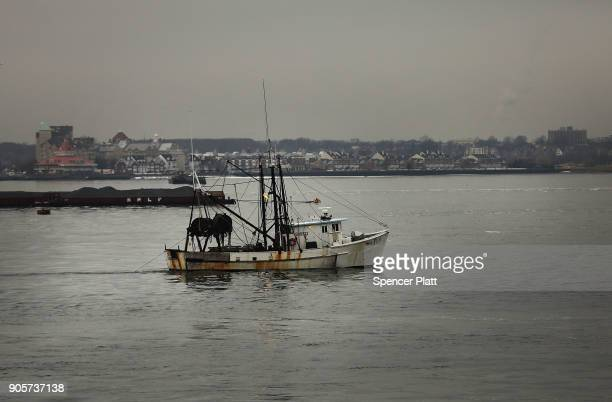 A fishing boat travels in New York Harbor on January 16 2018 in New York City New York Governor Andrew Cuomo has written a letter to Interior...