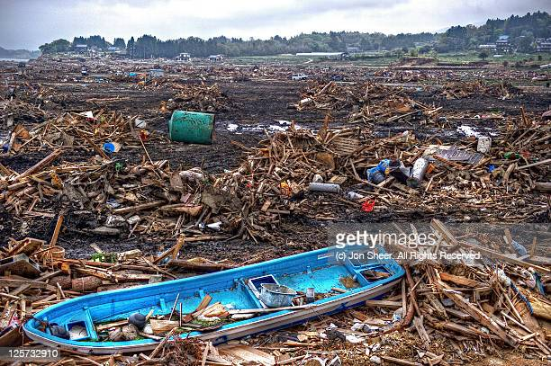 Fishing boat washed in land by tsunami