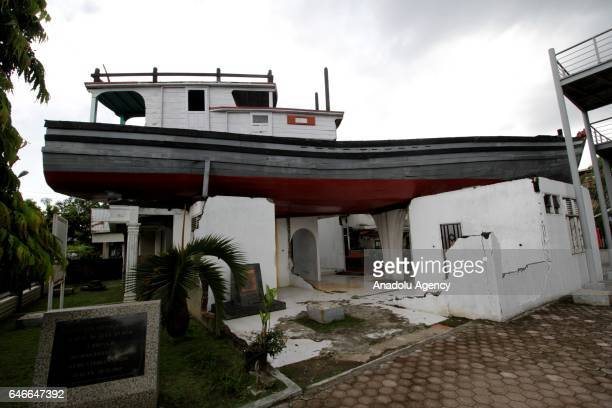 A fishing boat which washed ashore from the Indian Ocean tsunami of 2004 and landed on top of a house in Lampulo village is seen in Banda Aceh...