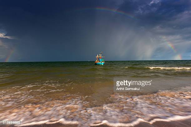 fishing boat with rainbow - prachuap khiri khan province stock pictures, royalty-free photos & images