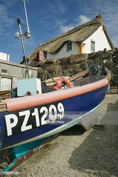 Fishing boats and a thatched cottage, Sennen Cove, nr Land's End, Cornwall, Great Britain.