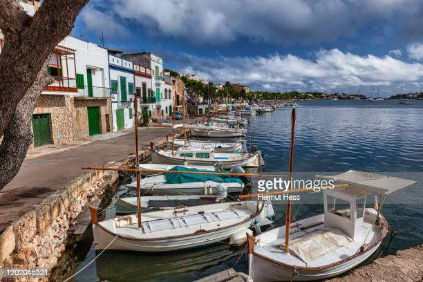 fishing boats and house facades from portocolom - majorca stock pictures, royalty-free photos & images