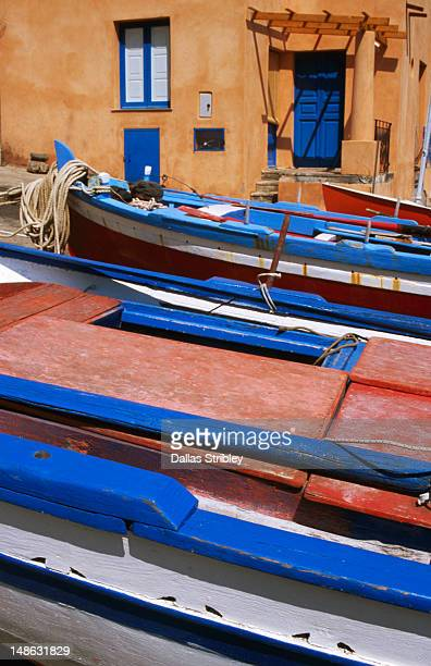 fishing boats and houses at village of rinella. - isola di salina sicilia foto e immagini stock