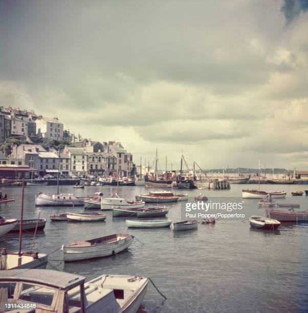 Fishing boats and rowing boats moored in the harbour at Brixham, a fishing town at the southern end of Torbay in Devon, England circa 1965.