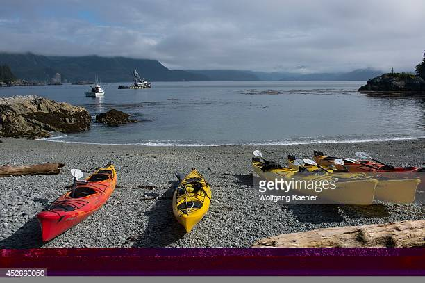 Fishing boats and sea kayaks on beach in bay at George Island off Chichagof Island Tongass National Forest Alaska USA
