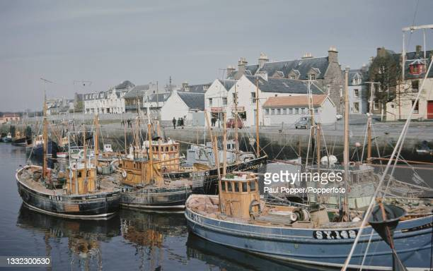 Fishing boats and trawlers moored in the inner harbour of Stornoway, the main town on Lewis and Harris, the largest island of the Western Isles, or...