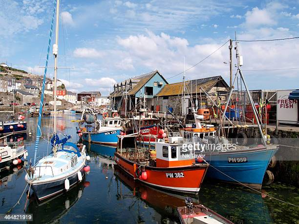 Fishing boats and yacht in Mevagissey harbour, Cornwall, UK