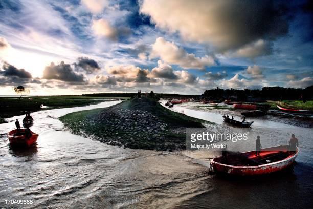 Fishing boats are coming back from sea to a fishing village near Sitakunda Chittagong Bangladesh