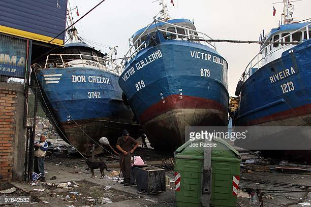 Fishing boats are docked after they were washed ashore in the recent earthquake and tsunami on March 11 2010 in Talcahuano Chile The fishing industry...