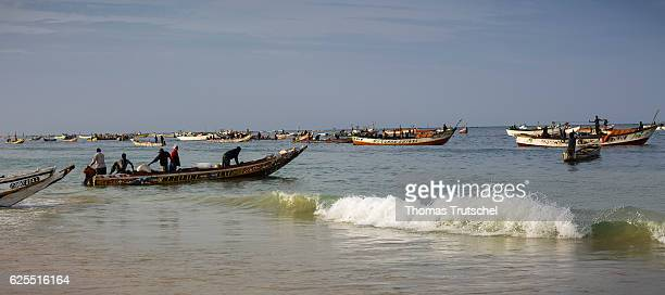 Fishing boats are located at a landing point of the fish market Nouakchott on November 16 2016 in Nouakchott Mauritania