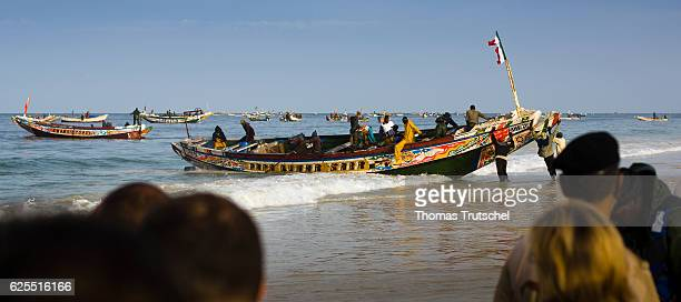 Fishing boats are located at a landing point of the fish market Nouakchott on November 16, 2016 in Nouakchott , Mauritania.