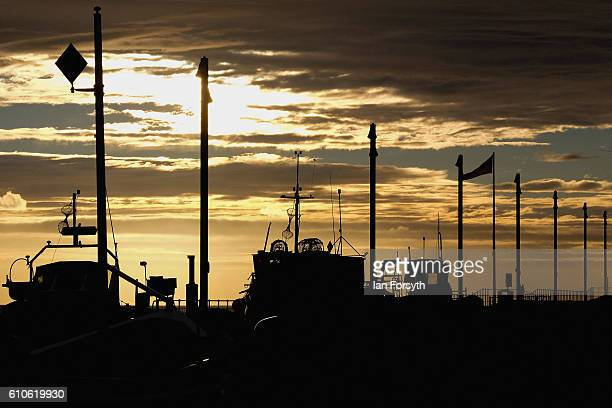 Fishing boats are parked along Redcar seafront on September 27 2016 in Redcar United Kingdom One year on since the SSI steel making plant at Redcar...