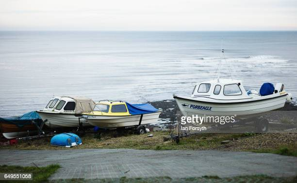 Fishing boats are parked on a hillside in Robin Hood's Bay on the North Yorkshire coast on March 8 2017 in Robin Hood's Bay United Kingdom Robin...