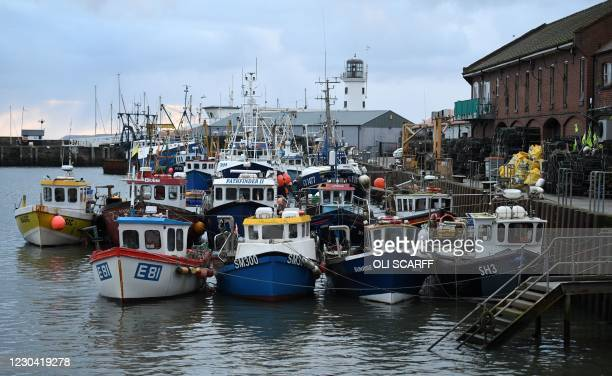 Fishing boats are pictured moored in the harbour at Scarborough, northeast England, on January 4, 2021. - Britain had insisted it wanted to take back...