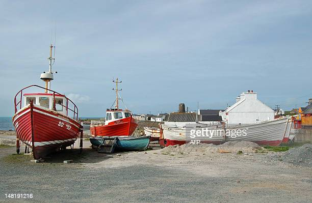 Fishing boats are pictured near the port of Tory Island off Ireland's northwest coast on June 9 2008 Tory Island off Ireland's northwest coast had...