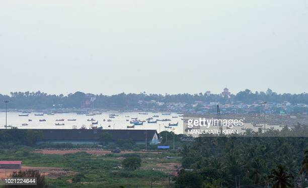 Fishing boats are seen anchored in the waters of the Arabian Sea near Kollam beach in the south Indian state of Kerala on August 22 2018 India's...