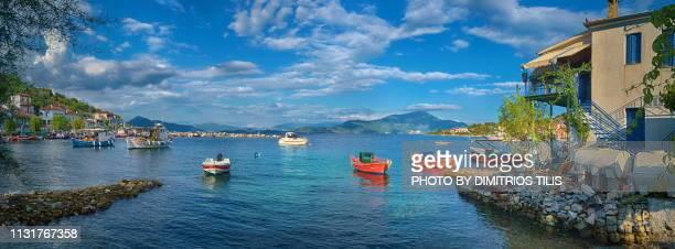 fishing boats at agia kyriaki coastal pelion 5 - volos stock pictures, royalty-free photos & images