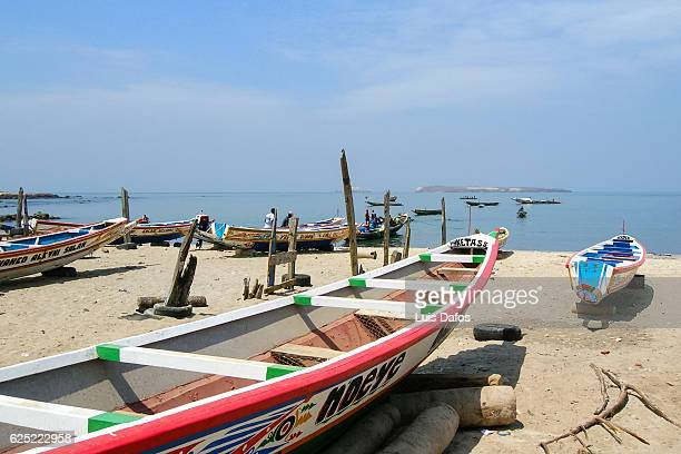 fishing boats at n'gor beach - dugout canoe stock photos and pictures