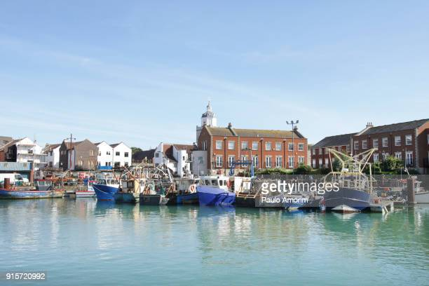 fishing boats at old port in portsmouth,england - portsmouth england stock pictures, royalty-free photos & images