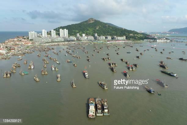 Fishing boats dock at liandao fishing port in Lianyungang City, East China's Jiangsu Province, July 24, 2021. Jiangsu many places in advance to...