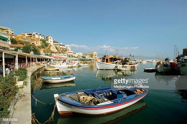 fishing boats docked at piraeus harbor, piraeus, greece - piraeus stock pictures, royalty-free photos & images