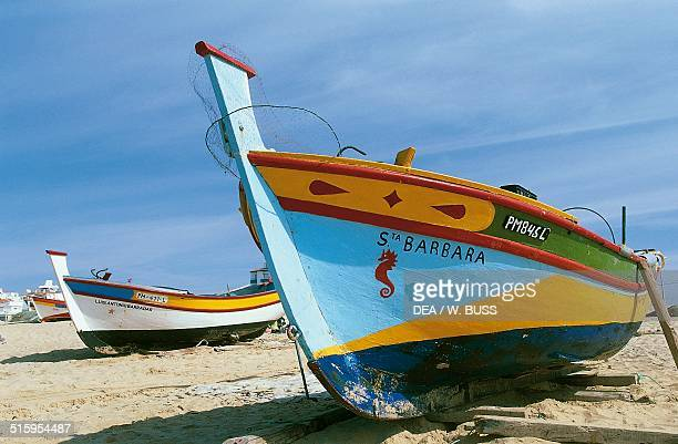 Fishing boats docked on the beach Armacao de Pera Algarve Portugal