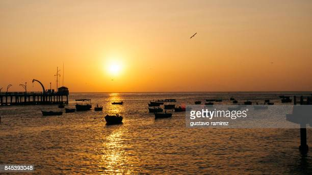 fishing boats fisherman's at the sunset - lima peru fotografías e imágenes de stock
