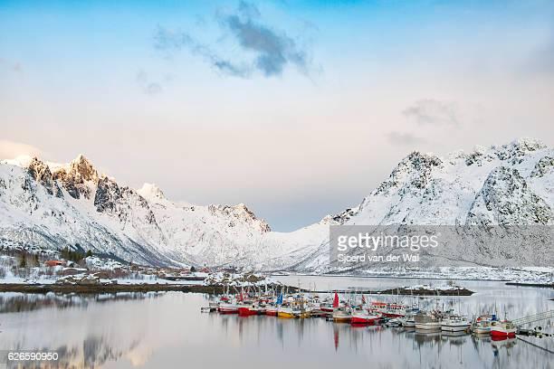 Fishing boats in Austnesfjorden in winter in the Lofoten Norway