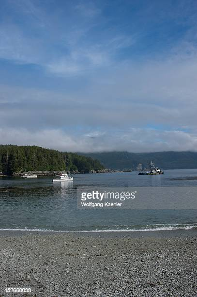 Fishing boats in bay at George Island, off Chichagof Island, Tongass National Forest, Alaska, USA.
