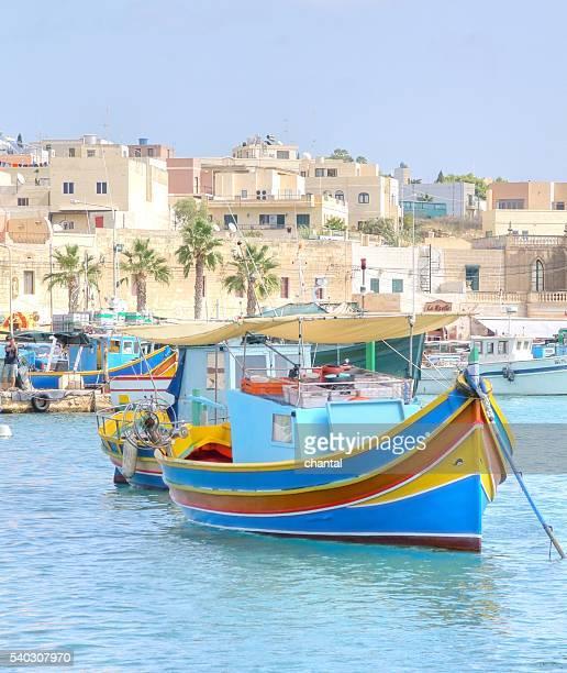 fishing boats in harbor of marsaxlokk - marsaxlokk stock pictures, royalty-free photos & images