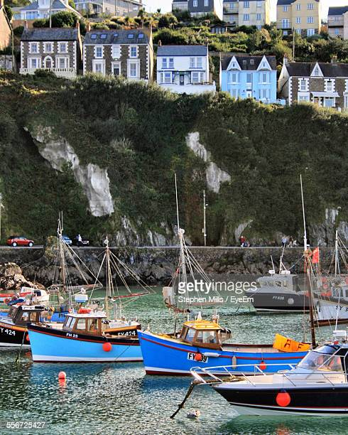 fishing boats in harbor - mevagissey stock photos and pictures