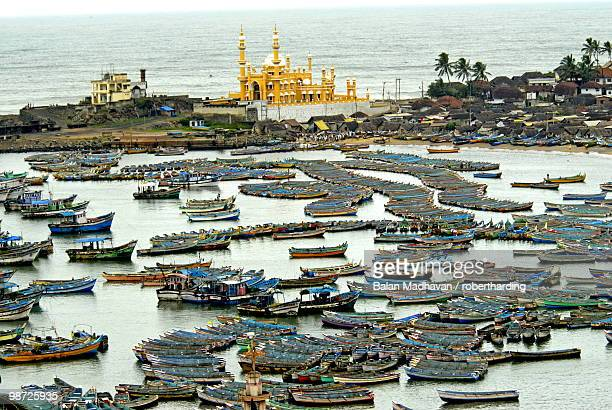 fishing boats in harbour, coastal area of vizhinjam, trivandrum, kerala, india - thiruvananthapuram stock photos and pictures